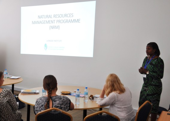 Natural Resource Management Programme Coordinator, Ms. Namwaka Omari (standing) delivering a presentation to journalists on UONGOZI Institute's work on supporting the management of natural resources in tanzania, with an emphasis on the oil and gas sector.